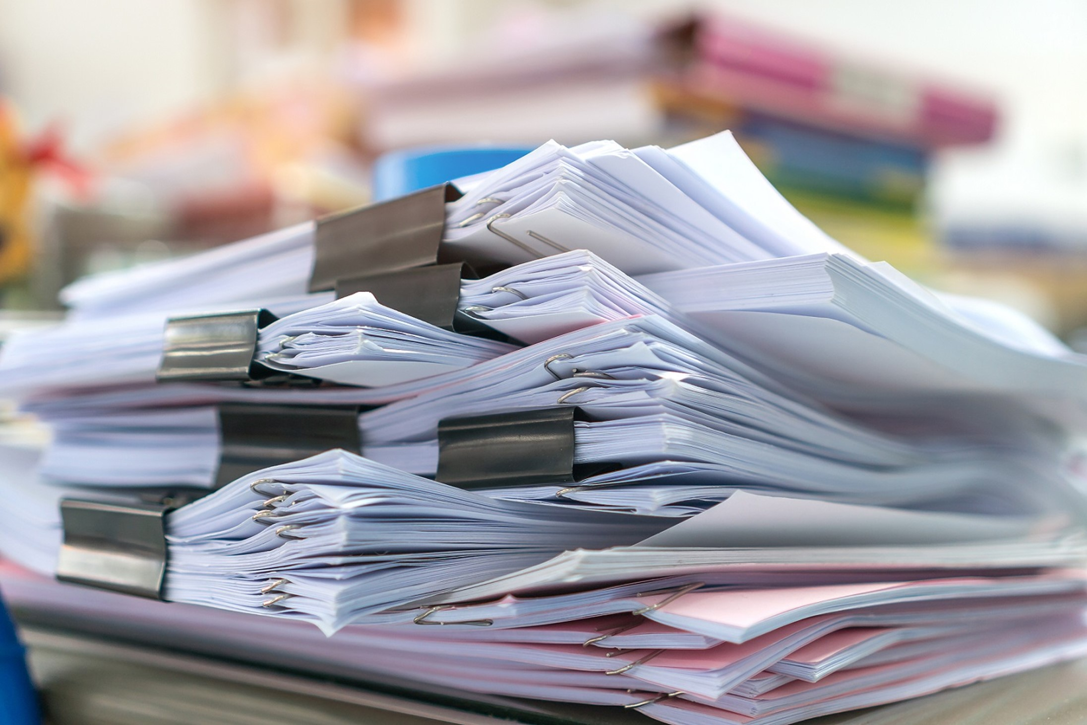 pile of business documents for processing